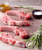 Raw meat, mutton, lamb rack on a wooden background Royalty Free Stock Image