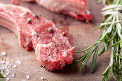 Raw meat, mutton, lamb rack on a wooden background Royalty Free Stock Photo