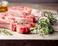 Raw meat, mutton, lamb rack on a wooden background Stock Photography