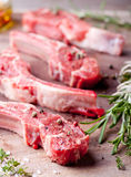 Raw meat, mutton, lamb rack on a wooden background Stock Images
