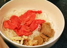 Raw meat and noodles Royalty Free Stock Image