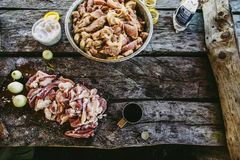 Raw meat on old wooden table, gray vintage decks background.  Royalty Free Stock Photos