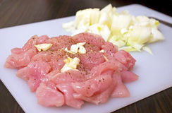 Raw meat with onion Royalty Free Stock Photography