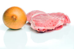Raw meat and onion Stock Images