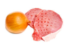 Raw meat and onion bulb Royalty Free Stock Photography