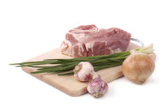 Raw meat with onion and garlic Stock Images