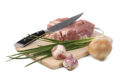 Raw meat with onion and garlic. Isolated on white Stock Images