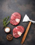 Raw meat osso buco and butchers axe. Top view Royalty Free Stock Photography