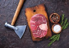 Raw meat osso buco and butchers axe. Top view Stock Images