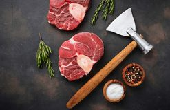 Raw meat osso buco and butchers axe. Top view Royalty Free Stock Image