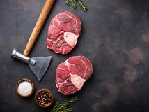 Raw meat osso buco and butchers axe. Top view Royalty Free Stock Photos