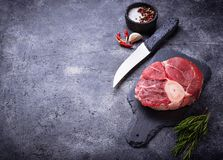 Raw meat osso buco on slate cutting board. Selective focus Stock Image