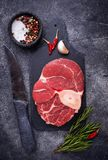 Raw meat osso buco on slate cutting board. Top view Royalty Free Stock Photography