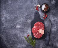 Raw meat osso buco on slate cutting board. Top view Stock Photos