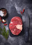 Raw meat osso buco on slate cutting board. Top view Royalty Free Stock Images