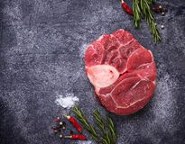 Raw meat osso buco with spices. Top view Stock Photos