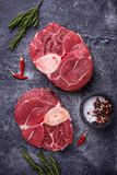Raw meat osso buco with spices. Top view Royalty Free Stock Photos