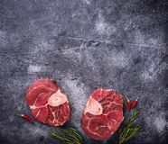 Raw meat osso buco with spices. Top view Royalty Free Stock Photography