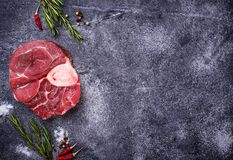 Raw meat osso buco with spices. Top view Stock Photography