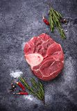 Raw meat osso buco with spices. Top view Stock Image