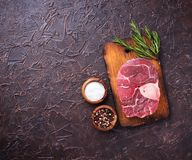 Raw meat osso buco with spices. Top view Royalty Free Stock Images
