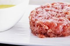 Raw meat over white plate Stock Images
