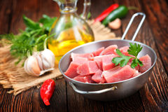 Raw meat. In pan and on a table Stock Photo