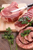 Raw meat and parsley Stock Image