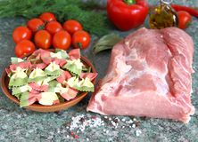 Raw meat, pasta and vegetables on the table. 