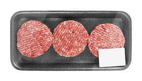 Raw meat patty in package. Isolated on white Stock Photography
