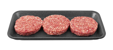 Raw meat patty in package. Isolated on white Stock Image