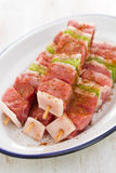 Raw meat with pepper for grill on white dish Stock Image