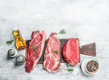 Raw meat. Pieces of beef and pork with spices and herbs stock image