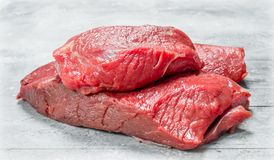 Raw meat. Pieces of beef stock image