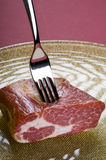 Raw meat on a plate. Over color background Royalty Free Stock Photography