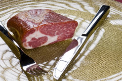 Raw meat on a plate. Over color background Royalty Free Stock Photos