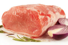 Raw meat pork. Fresh raw meat pork with onion and rosemary Stock Photos