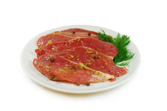 Raw meat. Pork escalope slices with sause  in a Dish Isolated Against White Background Royalty Free Stock Photo