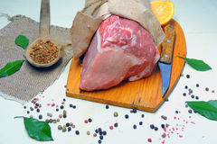 Raw meat. Pork. Raw meat selection on wooden cutting board with knife Stock Photos