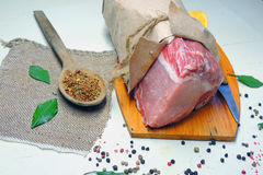 Raw meat. Pork. Raw meat selection on wooden cutting board with knife Royalty Free Stock Photography