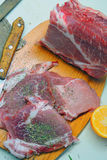Raw meat. Pork. Raw meat selection on wooden cutting board with knife Stock Photo