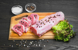 Raw meat pork tenderloin on cutting board Stock Photography