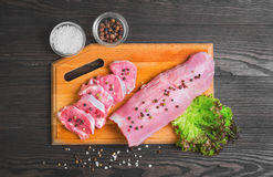 Raw meat pork tenderloin on cutting board Stock Photos