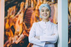 Raw meat production factory worker. Industry process Royalty Free Stock Image