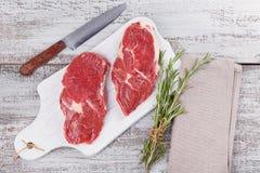 Raw fresh beef steak on a white cutting board Royalty Free Stock Photos