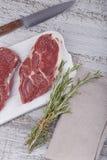 Raw fresh beef steak on a white cutting board Royalty Free Stock Photo
