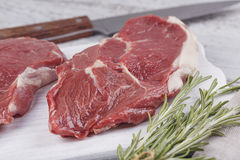 Raw fresh beef steak on a white cutting board Stock Photography