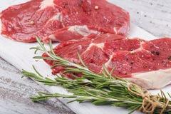 Raw fresh beef steak on a white cutting board Stock Photo