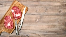 Raw meat Rib eye Steak wooden kitchen table Food background stock photos