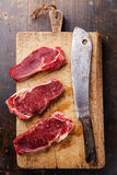 Raw meat Ribeye steak entrecote and meat cleaver Royalty Free Stock Photography